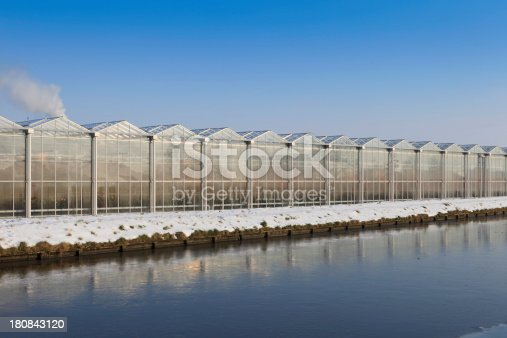 side view of an agricultural greenhouse used for the cultivation of flowers and vegetables