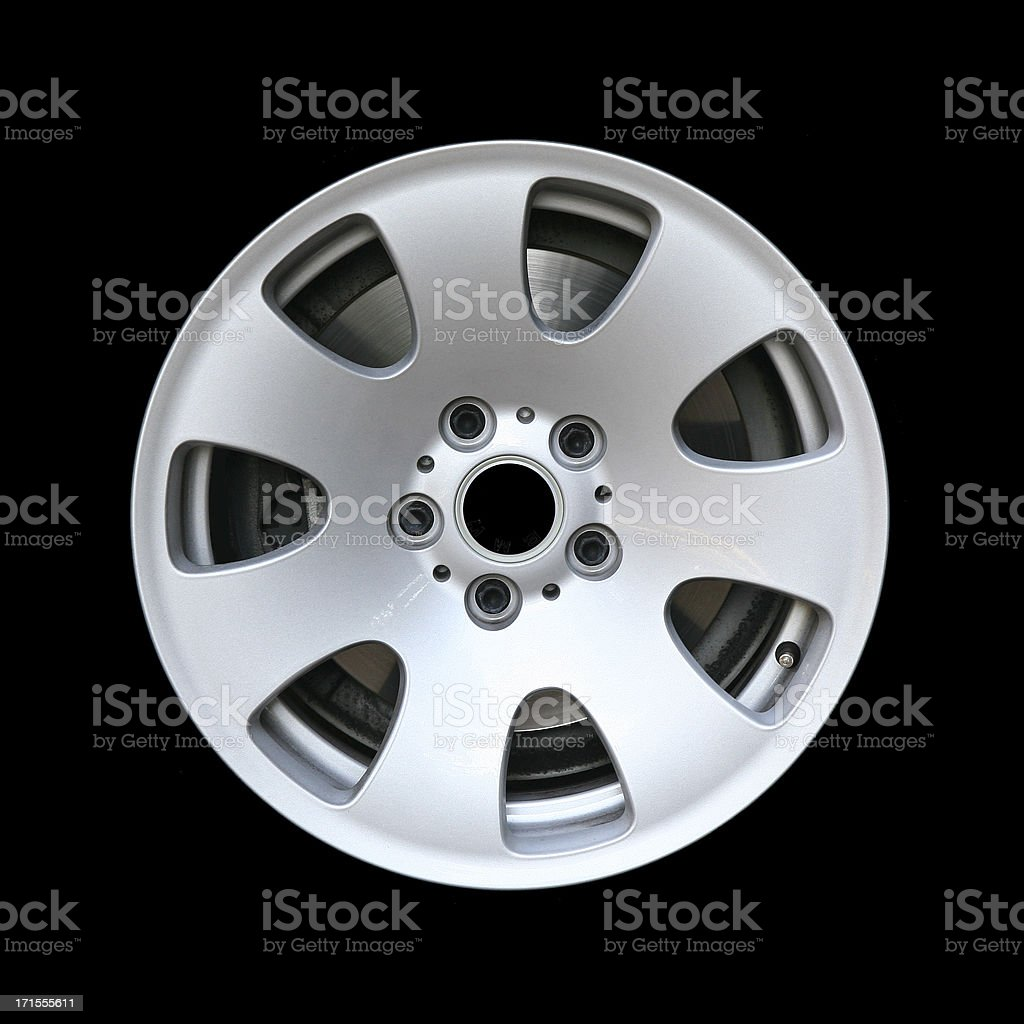 Side view of an alloy car wheel, isolated on black royalty-free stock photo
