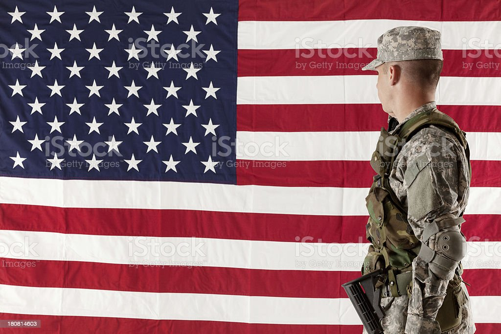 Side view of an army man looking at American flag royalty-free stock photo