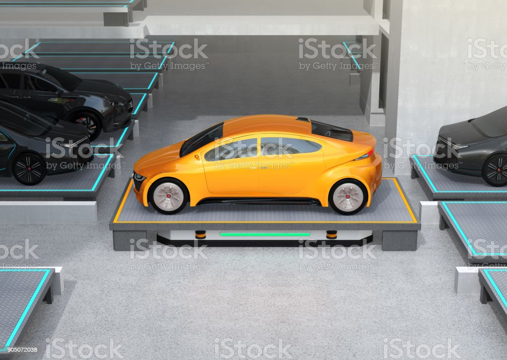 Side view of an (AGV) carrying a yellow car to parking space stock photo