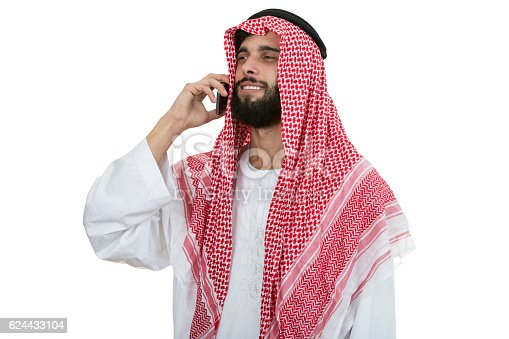 istock Side view of  arab saudi emirates man using  smart phone. 624433104