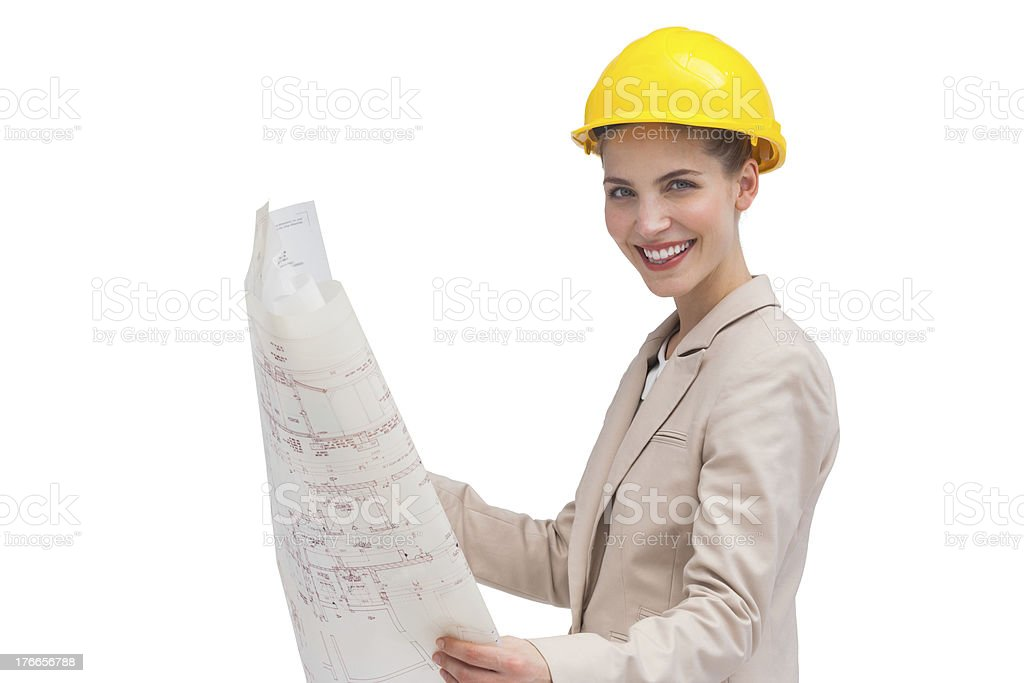 Side view of architect holding construction plan royalty-free stock photo