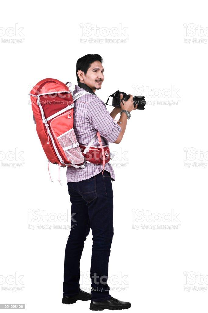 アジアの写真家が写真を撮るの側面図 - 1人のロイヤリティフリーストックフォト