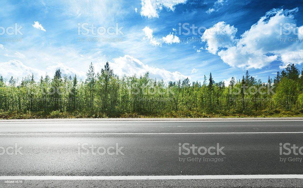 Side view of asphalt road and forest stock photo