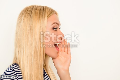 istock Side view of attractive happy woman making add 615477952