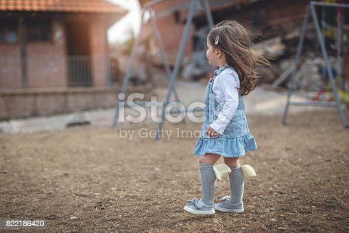678589610istockphoto Side view of baby girl at the park 822186420