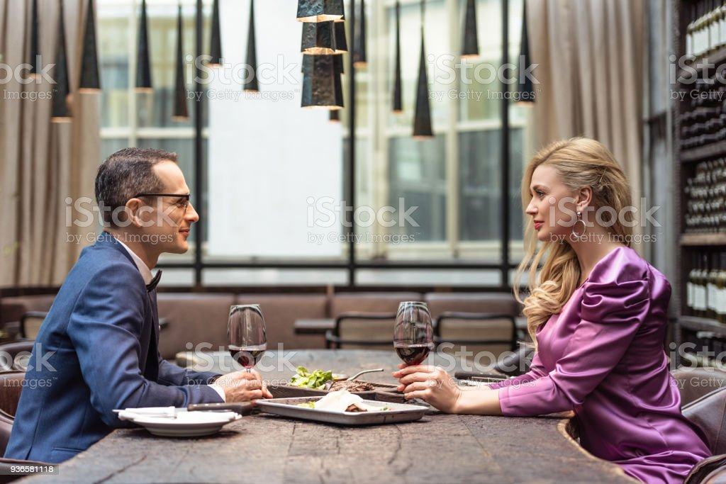 Side View Of Beautiful Adult Couple Having Date At Luxury Restaurant Stock Photo Download Image Now Istock