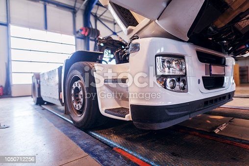 istock Side view of big truck in car workshop. Repairing old truck or making new in workshop. 1050712256