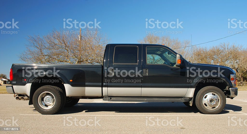 Side view of black and gray double cab pick-up truck outside royalty-free stock photo