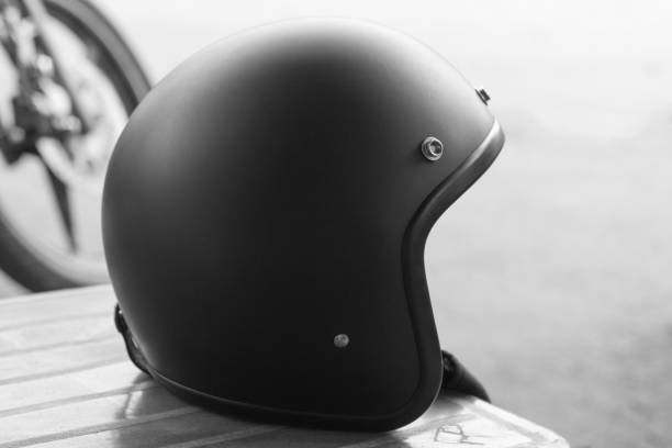 side view of black color vintage style motorcycle helmet - crash helmet stock photos and pictures