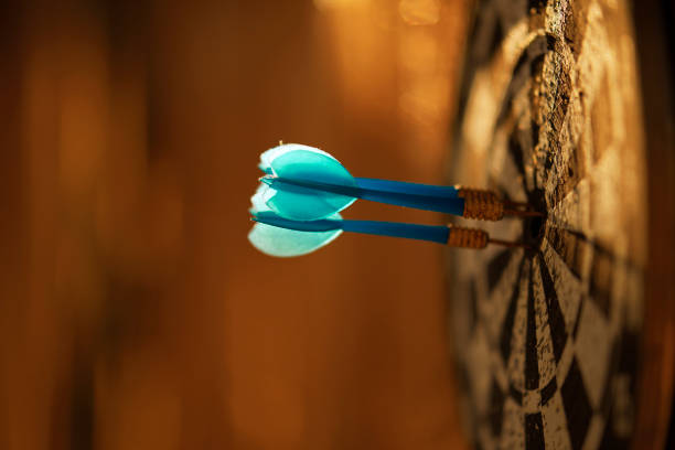 side view of blue darts arrows stock photo