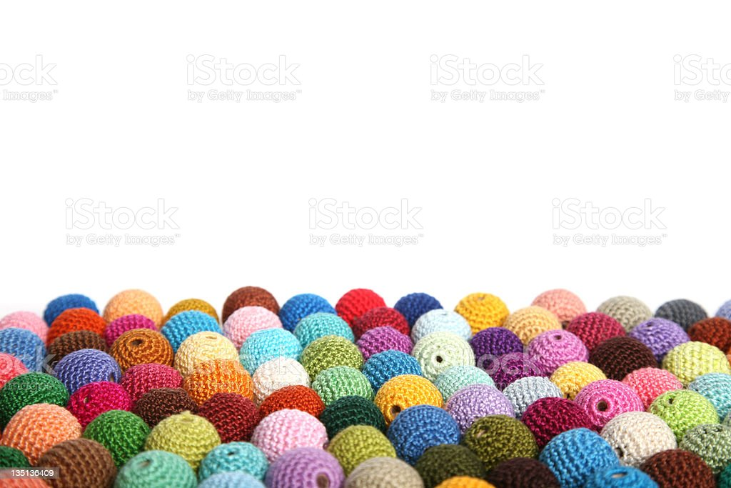 Side view of bulk of colorful cotton handmade crochet beads royalty-free stock photo