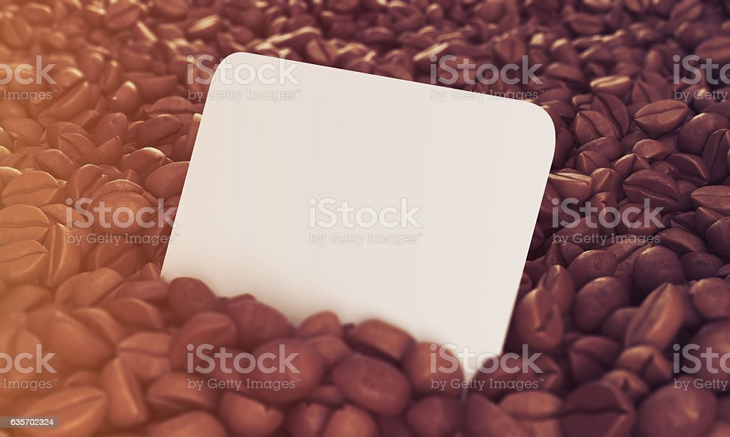 Side view of business card in coffee beans, toned royalty-free stock photo