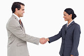 istock Side view of business partners shaking hands 824924618