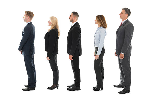 Side View Of Business People Standing In Row ストックフォト