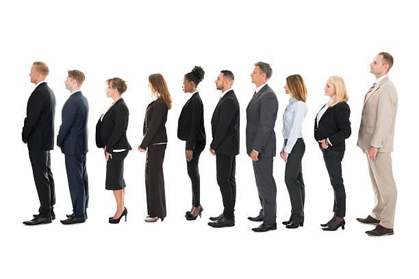 side view of business team standing in row - schwarze schlange stock-fotos und bilder