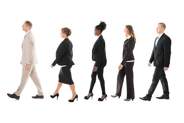 side view of business team walking in row - schwarze schlange stock-fotos und bilder