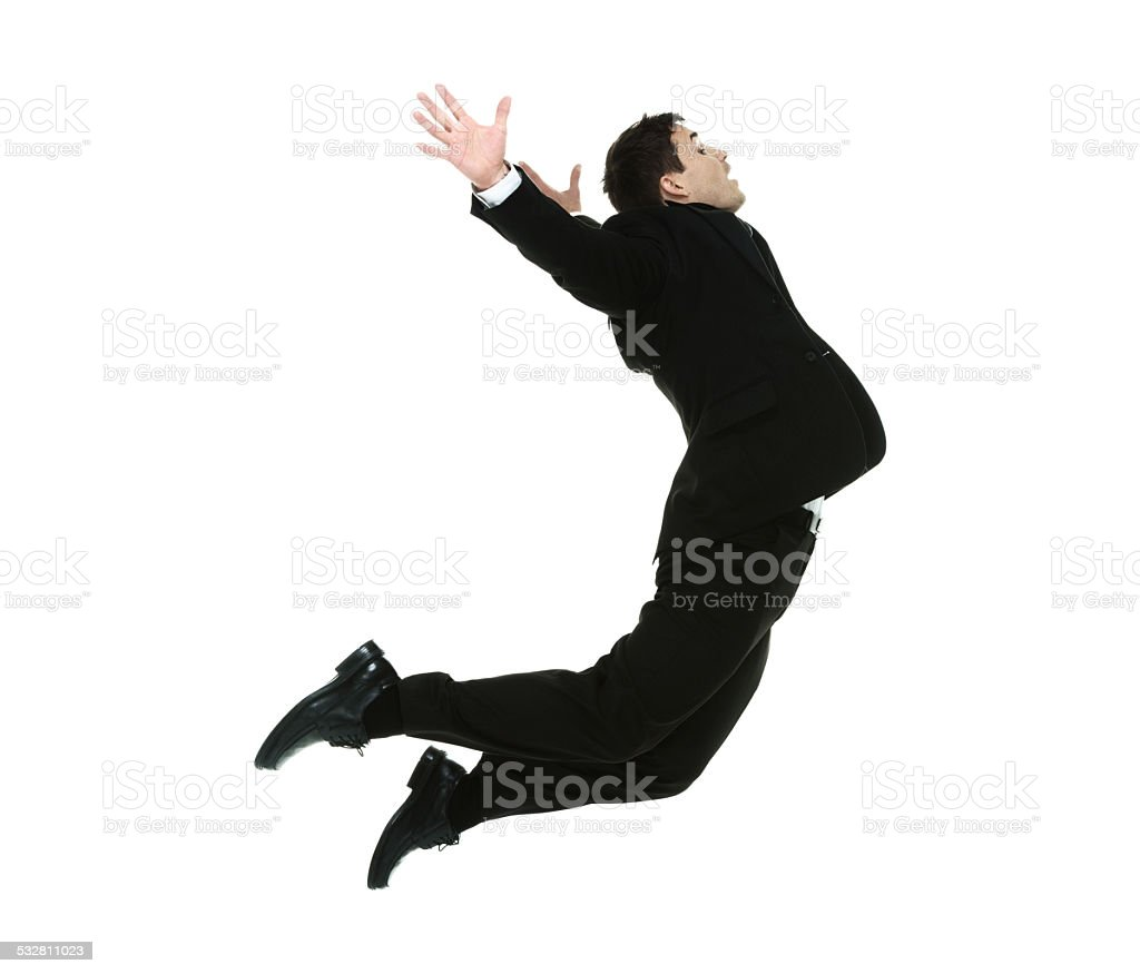 Side view of businessman jumping stock photo