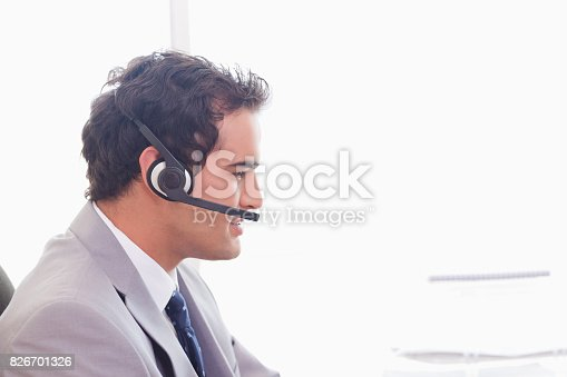 istock Side view of businessman with headset on 826701326