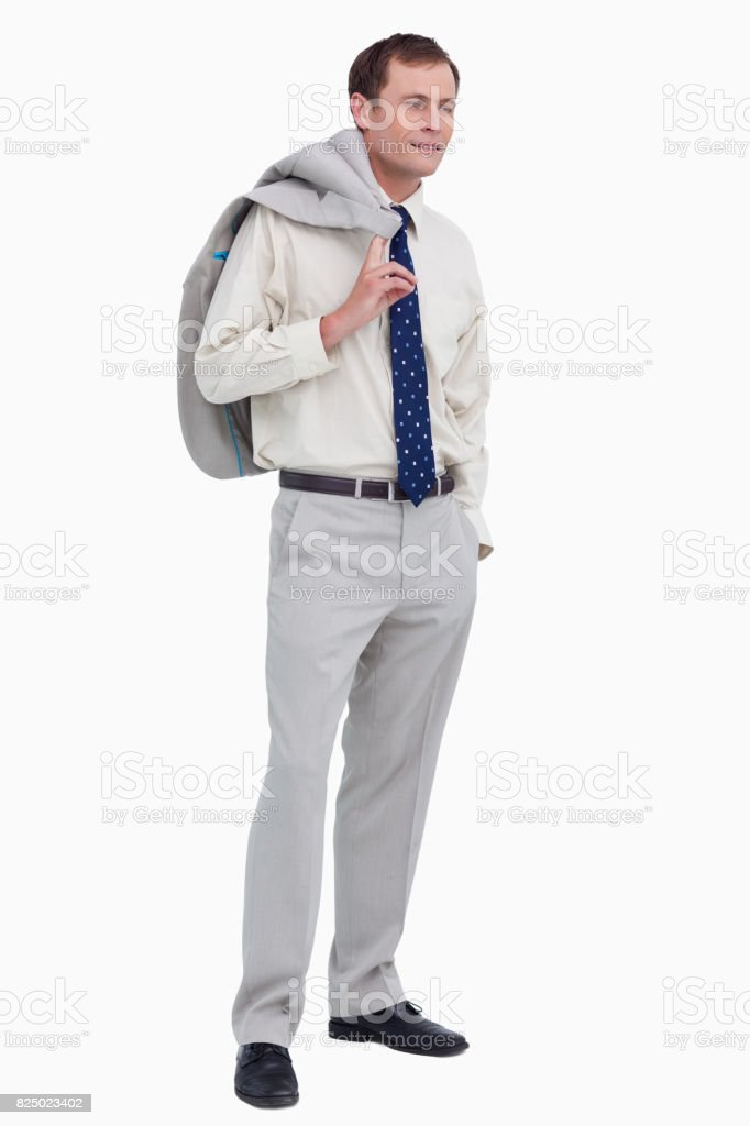 Side view of businessman with jacket over his shoulder stock photo