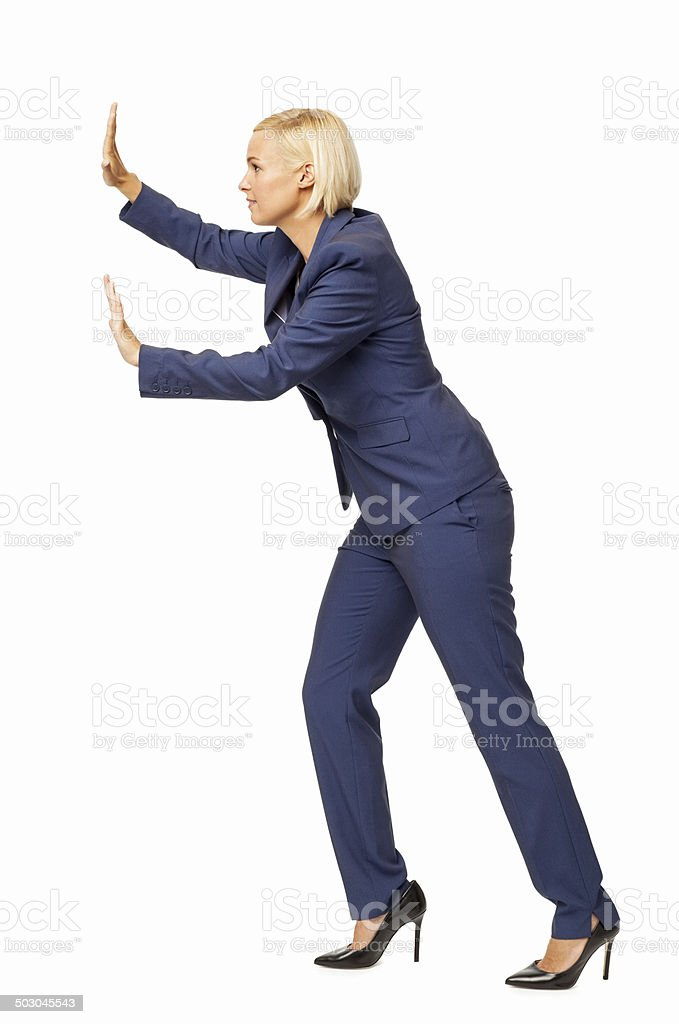 Side View Of Businesswoman Pushing Invisible Wall stock photo