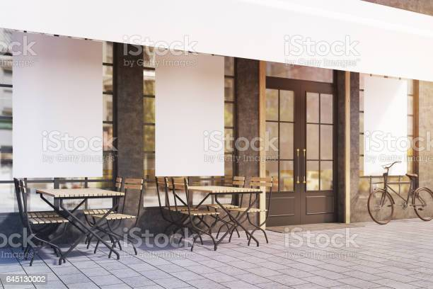 Side view of cafe windows with posters toned picture id645130002?b=1&k=6&m=645130002&s=612x612&h=jlx7rvldnd0liyrftev2l3zzs8yrobhkcrqbwvur0v8=