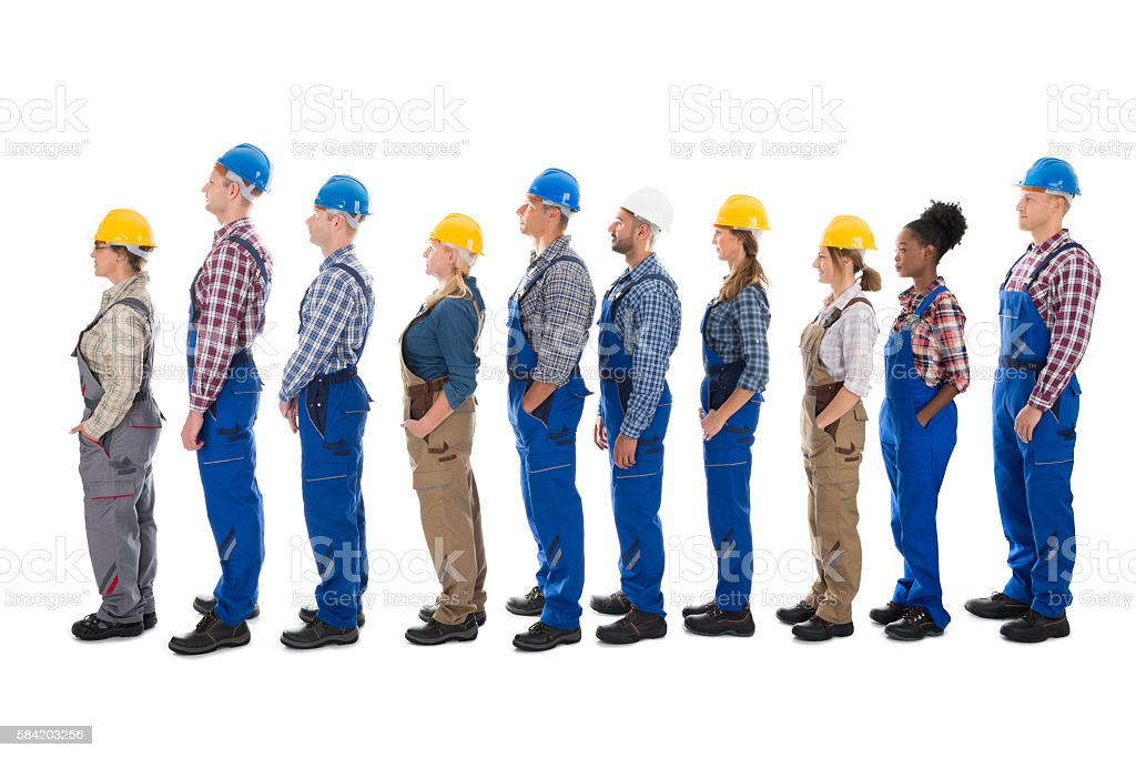 Side View Of Carpenters Standing In Line stock photo