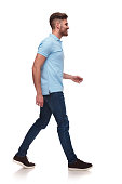 istock side view of casual man in blue polo shirt walking 1091245772