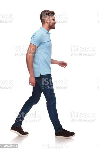 Side view of casual man in blue polo shirt walking picture id1091245772?b=1&k=6&m=1091245772&s=612x612&h=pe94nyj7zuhcg4x6b9iykrvaodts8q4m7ve7aqrgmdi=