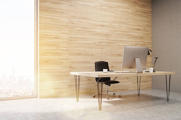 Side view of CEO working desk in office with panels stock photo