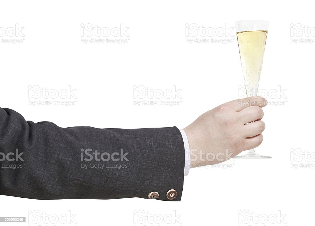 side view of champagne glass in businessman hand stock photo