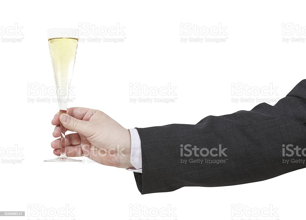 side view of champagne glass in male hand stock photo
