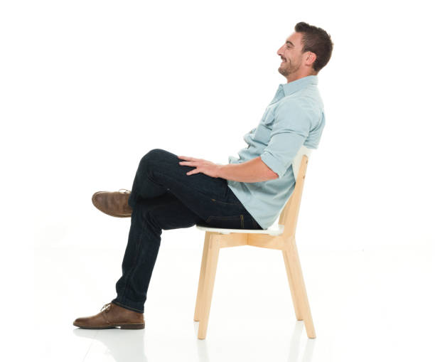 side view of charming man seated - sitting stock pictures, royalty-free photos & images