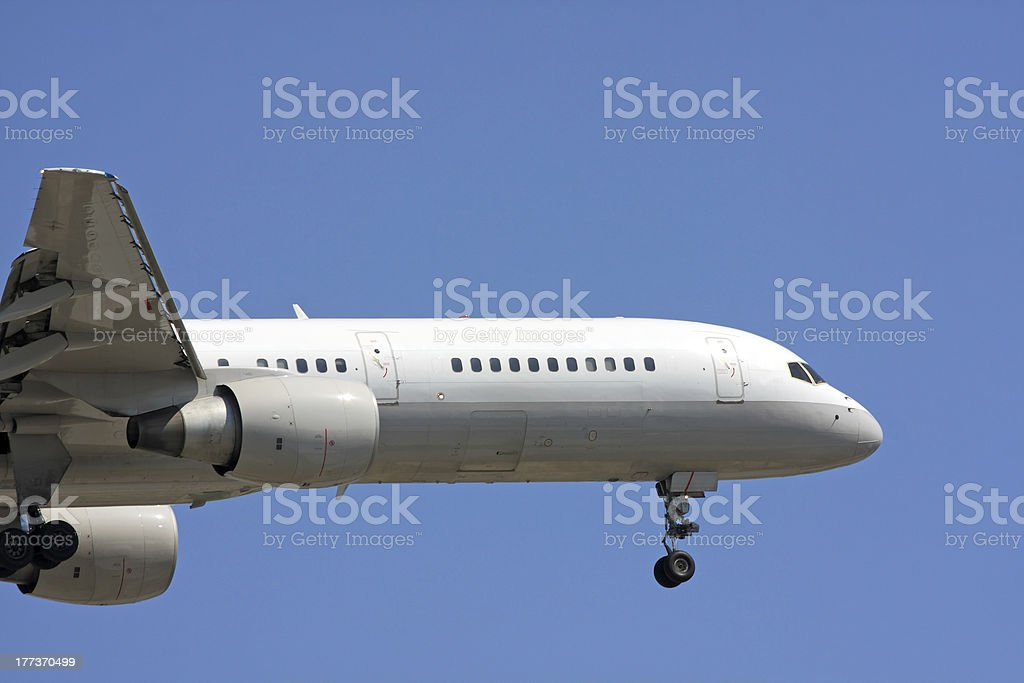 Side view of commercial aircraft in flight stock photo