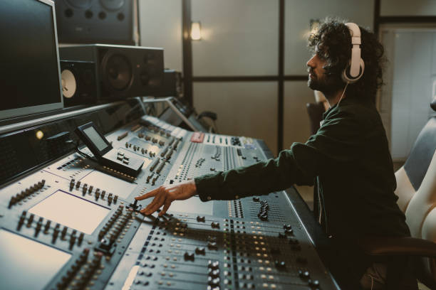 side view of concentrated sound producer working at studio stock photo
