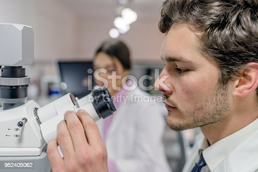 istock Side view of Concentrated student  biochemist working  in a laboratory 952405062