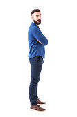 istock Side view of confident serious cool man with crossed arms looking at camera. 931174238