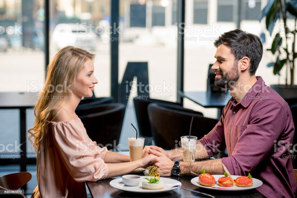 Side View Of Couple In Love Having Lunch Together In Restaurant Stock Photo Download Image Now Istock