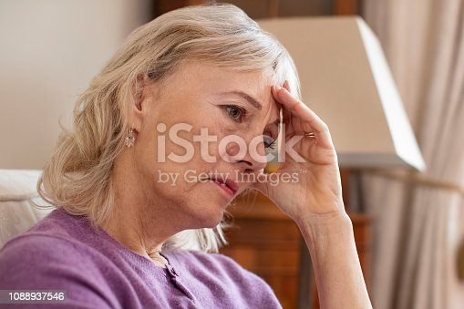 874789168istockphoto Side View Of Depressed Senior Woman At Home 1088937546