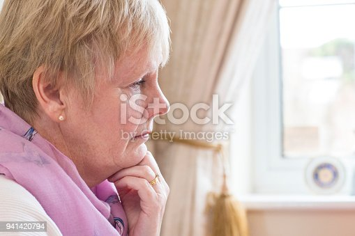 874789168istockphoto Side View Of Depressed Senior Woman At Home 941420794