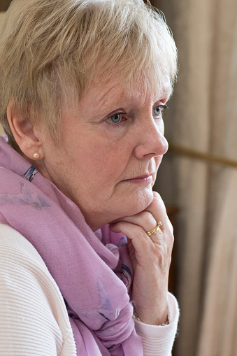 874789168 istock photo Side View Of Depressed Senior Woman At Home 951641102