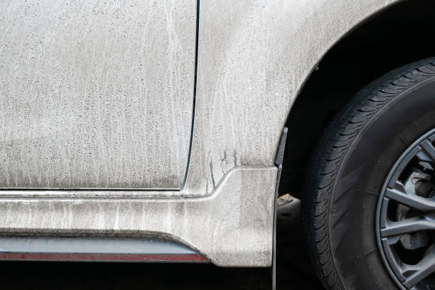 Side view of dirty white car stock photo
