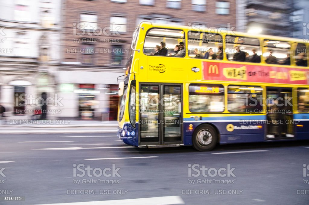 Side view of double-decker bus in downtown O'Connell street of Dublin Ireland during rush hour a day of autumn stock photo
