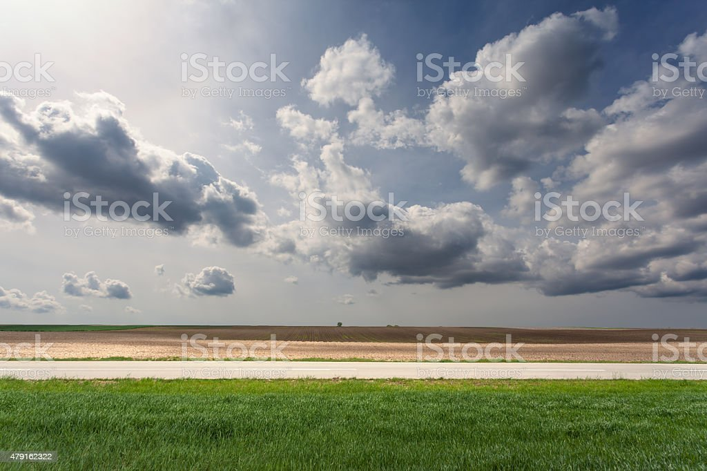 Side view of empty asphalt road at sunny day stock photo