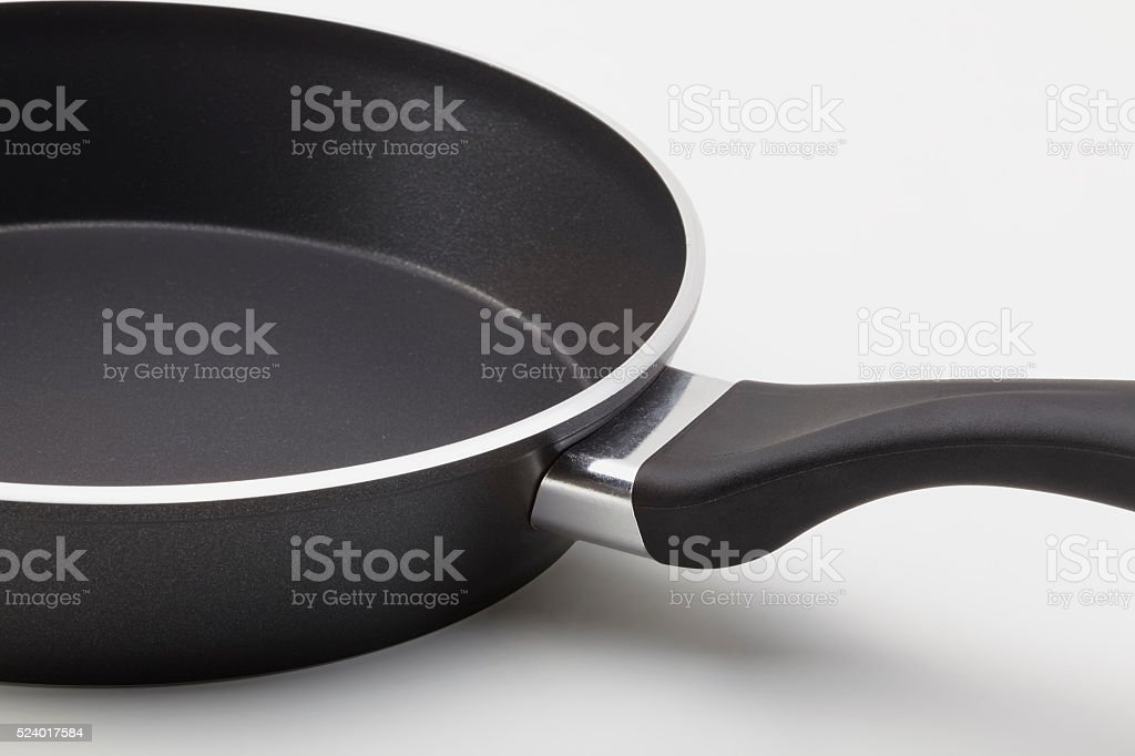 Side view of empty frying pan. stock photo
