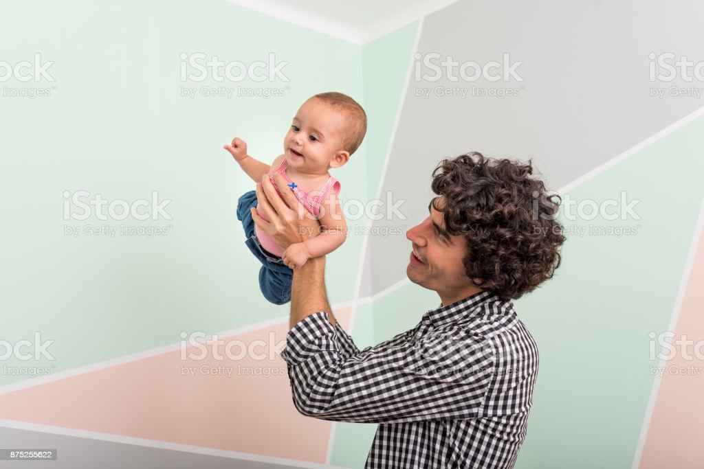 Side view of father carrying cute son stock photo