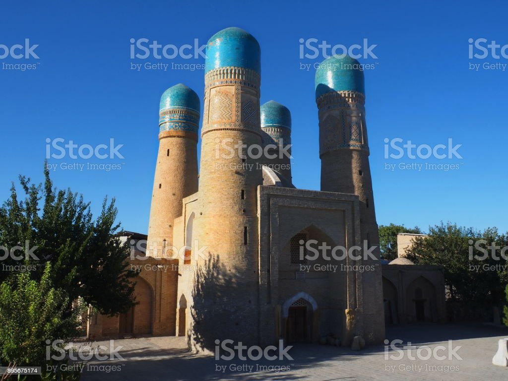 Side view of four minarets from Char Minor an old Madrasah in Bukhara, Uzbekistan stock photo