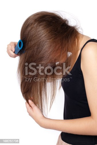 istock Side view of girl combing hair 168252708
