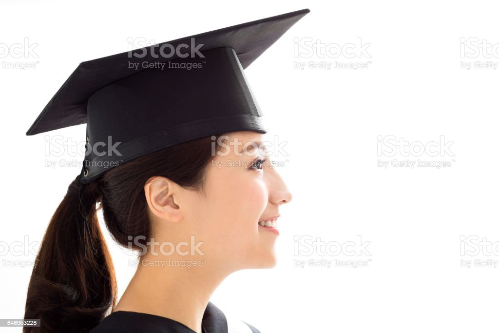 side view of Happy female graduate student stock photo