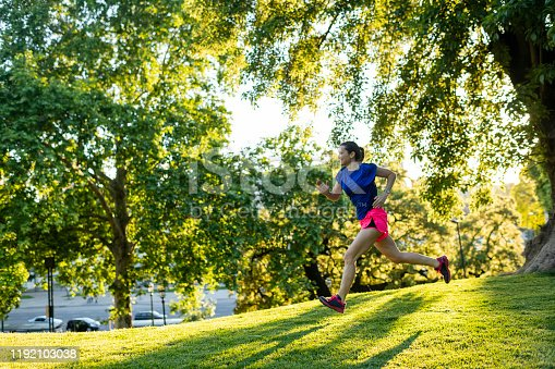Side view of woman running in a pubic park
